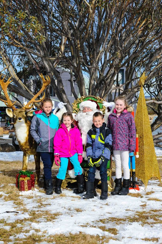 Kids with The Real Santa in the snow