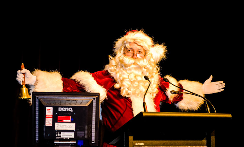Santa in front of lectern