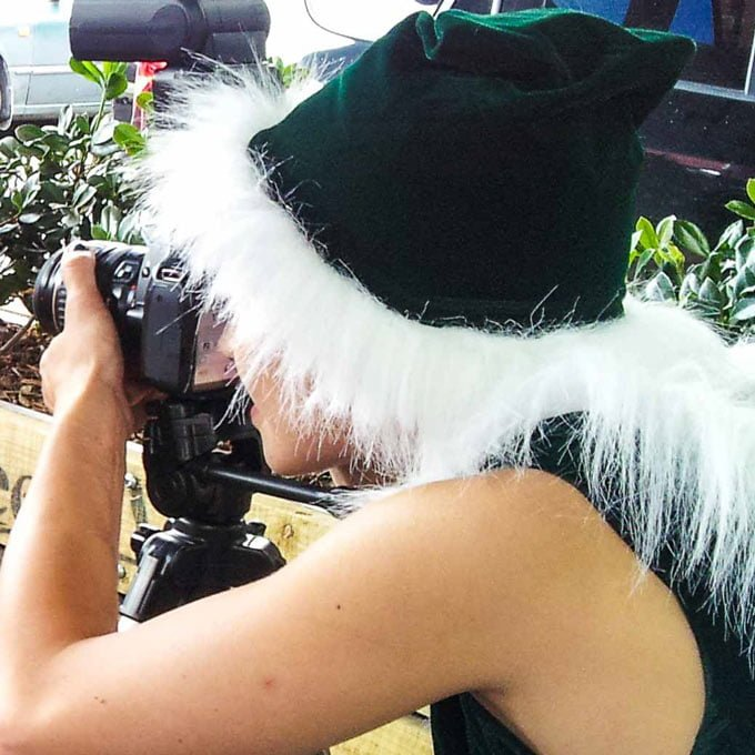 Photographer Elf behind camera
