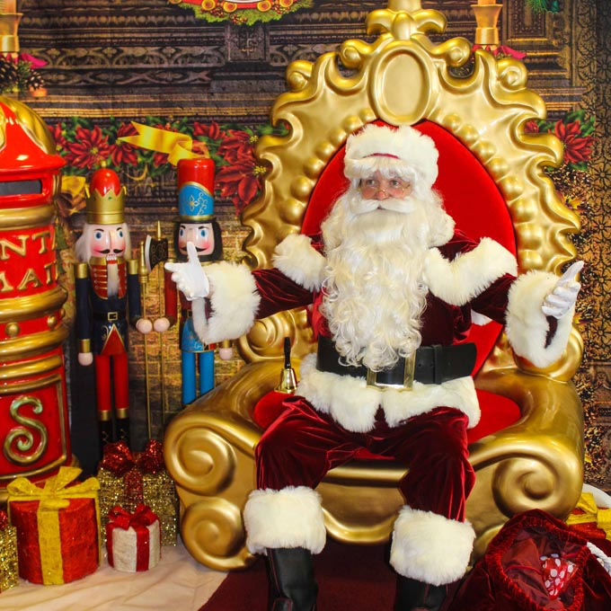 Santa on Majestic Red Gold Throne